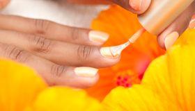 Woman applying nail polish